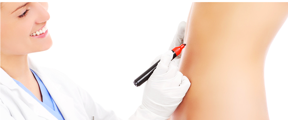 a doctor tracing on the tummy of a woman
